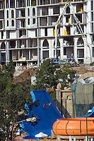 Elenite, Bulgaria..Tourists on water slides surrounded by resort construction at the north end of Sunny Beach, the largest resort area in the Balkans, and popular with cheap foreign package tours. Rapid overdevelopment of the Back Sea coast has led to widespread environmental destruction, and many properties lie uncompleted or empty.