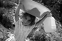 Turkey 1998.In a shantytown where Kurds are living, near Istanbul airport, water duty for a little girl.Turquie 1998.Dans un bidonville pres de l'aeroport d'Istamboul ou vivent les Kurdes chasses de leurs villages , corvee d'eau pour une petite fille.