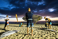 Namotu Island Resort, Namotu, Fiji. (Saturday May 30, 2014) Joel Parkinson (AUS), Kieren Perrow (AUS, Mick Fanning (AUS) and Freddy Patacchia (HAW) getting ready  before sunrise to catch the first boat out to Cloudbreak.–  The swell had really dropped back overnight to around 2'-3' at Cloudbreak this morning.  A remainder of the Top 34 have arrived in Fiji getting ready for the start of the Fiji Pro waiting period tomorrow. Photo: joliphotos.com