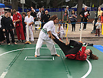 Merrick, New York, USA. 27th September 2015. Two female students of Goshinkan Jujitsu Dojo Family Self Defense Center demonstrate jujitsu moves at the Merrick Fall Festival.