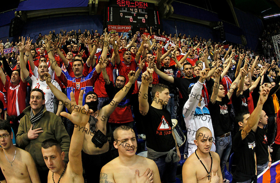 BELGRADE, SERBIA - JANUARY 17: Serbian national handball team supporters during the Men's European Handball Championship 2012 group A match between Serbia and Denmark at Pionir Arena on January 17, 2011 in Belgrade, Serbia. (Photo by Srdjan Stevanovic/Getty Images)