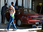 (02-12-02) SAN BERNARDINO--A SECTION--The 20-year-old woman in the foreground is the owner of the car which went through the wall of the La Salle Medical Clinic in San Bernardino, Tuesday. Her 15-year-old brother as at the driver's wheel while she was inside. She left him the keys so that he could turn on the engine for air conditioning. STAFF PHOTO BY Rodrigo Pe-a.