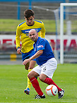 Cowdenbeath v St Johnstone....21.07.12  pre-season friendly.Colin Cameron fends off a St Johnstone trialist.Picture by Graeme Hart..Copyright Perthshire Picture Agency.Tel: 01738 623350  Mobile: 07990 594431