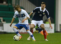 Italy U21 Giuseppe De Luca controls the ball infront of Scotland U21 Lewis Toshney