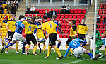 St Johnstone v Livingston...24.08.11   Scottish Communities League Cup Round 2.Frazer Wright shoots and his shot hits Murray Davidson to go in for the frist goal, there is some dispute over who scored.Picture by Graeme Hart..Copyright Perthshire Picture Agency.Tel: 01738 623350  Mobile: 07990 594431