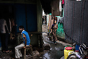 Residents carry on with their daily chores at the Muslim Camp Basti, Dhabiatalab in Kolkata, West Bengal, India.<br /> On Polio Days, small booths are set up in different parts of the city, urging local residents to vaccinate their children below 5 years.