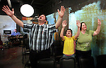 Chris, Taet and Debra Sanders sing during a worship service on Wednesday, Oct. 24, 2012 in London, Ky. Photo by Latara Appleby