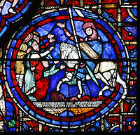 The knight Thibault VI, Count of Chartres, with the banner of Champagne, on horseback with crowds of people kneeling to thank him, donor window from the Zodiac and the labours of the months stained glass window, 1217, in the ambulatory of Chartres Cathedral, Eure-et-Loir, France. This window would have been donated by the pious to thank Thibault, who, on the orders of Thomas du Perche, donated land for a vineyard to a religious institution. This calendar window contains scenes showing the zodiacal symbol with its corresponding monthly activity. Chartres cathedral was built 1194-1250 and is a fine example of Gothic architecture. Most of its windows date from 1205-40 although a few earlier 12th century examples are also intact. It was declared a UNESCO World Heritage Site in 1979. Picture by Manuel Cohen
