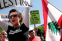 Maral S. (foreground), takes part in a march protesting recent Israeli military action in Lebanon.  The march lead to a rally in front of Occidental Petroleum on Wilshire Blvd., Calif., on Saturday, Aug. 5, 2006. Maral attended the rally with her mother. (Photo by Bryce Yukio Adolphson/Brooks Institute of Photography, &copy;2006)<br />
