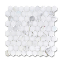 3 cm Hex shown in Statuary Carrara (available in honed or polished finish) is part of New Ravenna's Studio Line. All mosaics in this collection are ready to ship within 48 hours.<br />