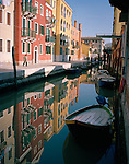 Colorful architecture reflected in a canal of Venice, Italy, Europe
