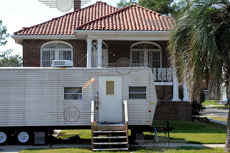 Many people in New Orleans are still living in trailers parked outside their homes three years on from Hurricane Katrina.