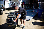 Geoff Gill inspects his paddle tire before installing it at the National Sand Drad Race Association's 2009 Summer Nationals in Avenal, CA May 17, 2009.