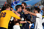 14 December 2014: Virginia's Riggs Lennon (shirtless) is mobbed by teammates after scoring the championship winning penalty kick. The University of Virginia Cavaliers played the University of California Los Angeles Bruins at WakeMed Stadium in Cary, North Carolina in the 2014 NCAA Division I Men's College Cup championship match. Virginia won the championship by winning the penalty kick shootout 4-2 after the game ended in a 0-0 tie after overtime.