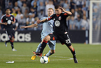 Perry Kitchen (23) midfield D.C Utd holds off thev challenge from Oriol Rosell (20) midfield Sporting KC ..Sporting Kansas City defeated D.C Utd 1-0 at Sporting Park, Kansas City, Kansas.