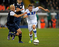Michael Bradley  (l,USA) vs. Claudio Marchisio (r, ITA), during the friendly match Italy against USA at the Stadium Luigi Ferraris at Genoa Italy on february the 29th, 2012.