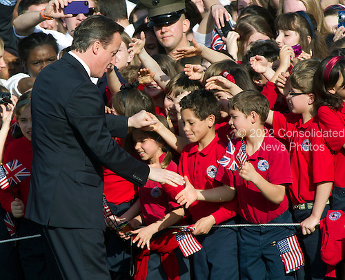 Prime Minister David Cameron of Great Britain greets students during the Arrival Ceremony in his honor at the White House in Washington, D.C. on Wednesday, March 14, 2012..Credit: Ron Sachs / CNP