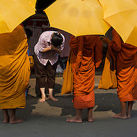 Buddhist Monks collecting their Aaims at the Russian Market Phnom Penh, Cambodia
