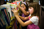 Bea, right, and Vivian  Ferrell look for books at a library in Auburn, CA  May 13, 2009.