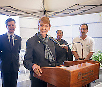 Manhattan Chamber of Commerce Pres. Nancy Ploeger at the opening of the 50th Street Commons, a 2400 square foot vest pocket park in Midtown Manhattan in New York on Tuesday, September 16, 2014. The brand new park is a by-product of the multi-billion dollar East Side Access project (ESA) bringing Long Island Railroad trains into Grand Central Terminal. The public space, which contains plantings, a colorful waterfall and seating, is on top of the access' ventilation facility with the new concourse hundreds of feet below. The ESA is one of the largest transit infrastructure projects in the U.S. schedule for completion in 2022. (© Richard B. Levine)