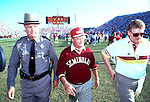 "Bobby Bowden grimices as he leaves the field with his long time Florida Highway Patrol security and Sports Information director Wayne Hogan after Miami defeated the Seminoles 17-16 in the 1991 game in Tallahassee that came to be known as the ""Wide Right"" game. (Mark Wallheiser/TallahasseeStock.com)"