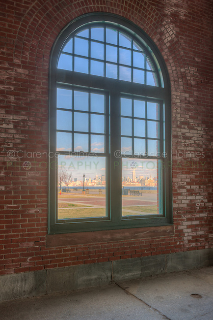 The skyline of Manhattan in New York City across the Hudson River as viewed from inside the Central Railroad of New Jersey (CRRNJ) Terminal in Liberty State Park, Jersey City, New Jersey