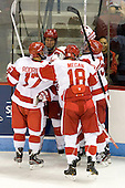 Evan Rodrigues (BU - 17), Ryan Ruikka (BU - 2), Wade Megan (BU - 18), Matt Grzelcyk (BU - 5) - The Boston University Terriers defeated the visiting Providence College Friars 4-2 (EN) on Saturday, December 13, 2012, at Agganis Arena in Boston, Massachusetts.