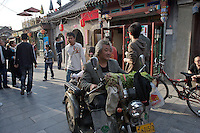 A crowded hutong or alleyway in the Shichahai area in Beijing,China.  Shichahai has retained the old style structures and hutongs and is a popular section attracting both tourists and locals.