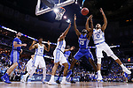 Kentucky Wildcats guard Dominique Hawkins and North Carolina Tar Heels guard Nate Britt fight for a rebound during the 2017 NCAA Men's Basketball Tournament South Regional Elite 8 at FedExForum in Memphis, TN on Friday March 24, 2017. Photo by Michael Reaves | Staff