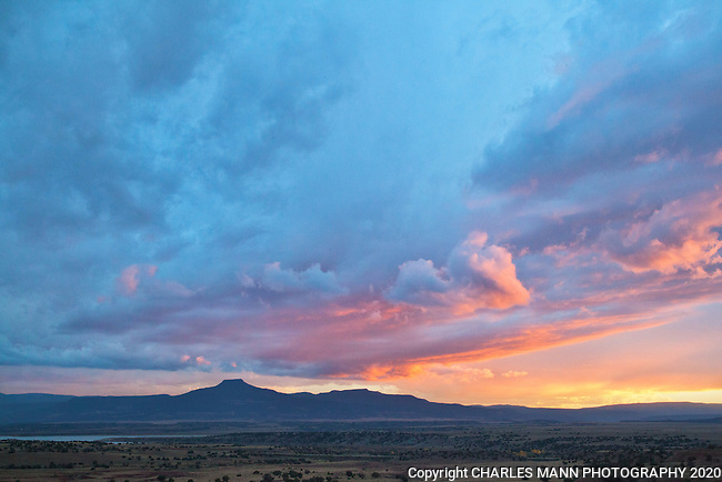 A moody sky dominates the landscape over the iconic peak of Pedernal northern in New Mexico at the  resort of Ghost Ranch near the village of Abiquiu.