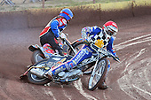 Heat 2: Shane Hazelden (blue) crashes out behind Brandon Freemantle - Hackney Hawks vs Team America - Speedway Challenge Meeting at Rye House - 09/04/11 - MANDATORY CREDIT: Gavin Ellis/TGSPHOTO - Self billing applies where appropriate - Tel: 0845 094 6026