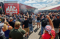 Sep 3, 2016; Clermont, IN, USA; Fans surround the pit area of NHRA top fuel driver Doug Kalitta as he warms up his car during qualifying for the US Nationals at Lucas Oil Raceway. Mandatory Credit: Mark J. Rebilas-USA TODAY Sports