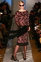 Model walks runway in an outfit from the Marlene Haute Couture Evening Collection, by Marlene Thomas, during Plitzs Fashion Week New York Fall 2012.