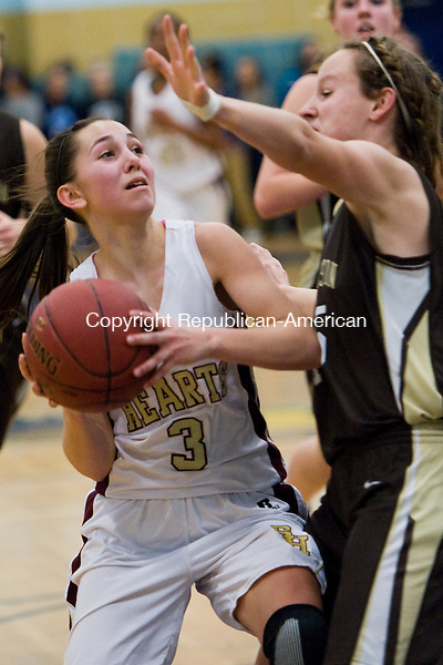 WATERBURY, CT-17 March 2014-031714EC12--   Sacred Heart's Maryn Vaillancourt looks to the net in front of Thomaston's Charlie Eberhardt at Kennedy High School Monday night. The Bears defeated the Hearts, 43-32. Erin Covey Republican-American