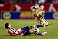 CD Chivas USA defender Ante Jazic (6) attempts a sliding tackle on Philadelphia Union forward Sebastien Le Toux (9). The Philadelphia Union and CD Chivas USA played to 1-1 draw at Home Depot Center stadium in Carson, California on Saturday evening July 3, 2010..