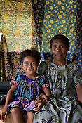 Jovina Lonevan, and her 6 year old daughter Rosemary, in Bain village in the Cape Orford logging concession (run by Rimbunan Hijau- Malaysian logging giants), in Bain, East New Britain Island, Papua New Guinea,  Friday 19th September 2008..Jovina was married to a Malaysian national, working in the logging industry near her village, and Rosemary is the product of that marriage. On completion of logging in that area the Malaysian man returned to his home country, leaving Jovina as a single mother..