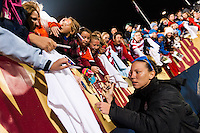 Lauren Cheney (12) of the United States (USA) signs autographs after the match. The United States (USA) and Germany (GER) played to a 2-2 tie during an international friendly at Rentschler Field in East Hartford, CT, on October 23, 2012.