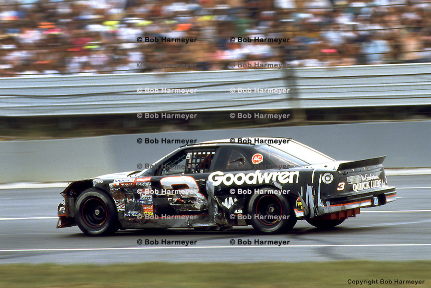 LONG POND, PA - JUNE 16: Dale Earnhardt drives his damaged car during the Champion Spark Plug 500 on June 16, 1991, at the Pocono International Raceway near Long Pond, Pennsylvania.