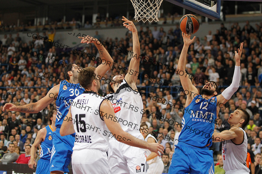 Kosarka Euroleague season 2013-2014<br /> Euroleague<br /> Partizan v Real Madrid<br /> Ioannis Bourousis  (L) Joffrey Lauvergne and Nikola Mirotic (R)<br /> Beograd, 02.01.2014..<br /> foto: Srdjan Stevanovic/Starsportphoto &copy;