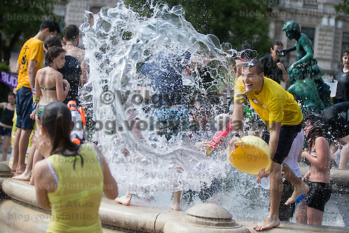 Young people participate a public water fight flashmob in downtown Budapest, Hungary on June 25, 2016. ATTILA VOLGYI
