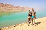 Couple Using Mud Therapy At The Dead Sea