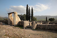 Entrance to the House of Orpheus, named after one of its mosaics of Orpheus playing his harp, Volubilis, Northern Morocco. Volubilis was founded in the 3rd century BC by the Phoenicians and was a Roman settlement from the 1st century AD. Volubilis was a thriving Roman olive growing town until 280 AD and was settled until the 11th century. The buildings were largely destroyed by an earthquake in the 18th century and have since been excavated and partly restored. Volubilis was listed as a UNESCO World Heritage Site in 1997. Picture by Manuel Cohen