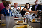 Republican presidential candidate Rep. Michele Bachmann greets diners over breakfast at a cafe in Spencer, Iowa, July 31, 2011 while campaigning througout the state in advance of the Straw Poll.