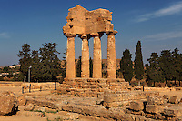 Low angle view of Temple Of Castor and Pollux, late 5th century BC, Agrigento, Sicily, Italy,  pictured on September 12, 2009, in the morning. Only four columns and part of the entablature of the Temple of Castor and Pollux or of the Dioscuri remain, a rosette on the corner. In 1836 the temple was excavated and restored by archeologists Villareale and Cavallari, commissioned by the Duke of Serradifalco. The Valley of the Temples is a UNESCO World Heritage Site. Picture by Manuel Cohen.
