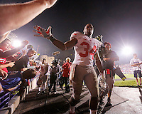 Ohio State Buckeyes running back Carlos Hyde (34) high fives fans following  the NCAA football game between Ohio State and Northwestern at Ryan Field in Evanston, Illinois on Saturday, October 5, 2013. (Columbus Dispatch photo by Jonathan Quilter)