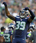 Seattle Seahawks Brandon Browner celebrates his 106-yard fumble return for a touchdown against the Denver Broncos at CenturyLink Field in Seattle, Washington on  August 17, 2013. The Seattle Seahawks beat the Broncos 40-10.     ©2013. Jim Bryant Photo. All Rights Reserved.