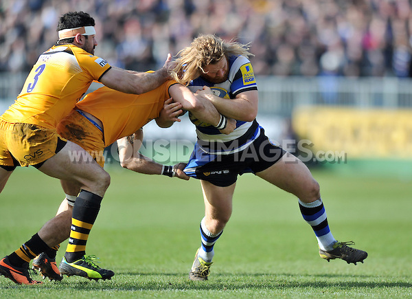 Ross Batty is tackled in possession. Aviva Premiership match, between Bath Rugby and London Wasps on February 22, 2014 at the Recreation Ground in Bath, England. Photo by: Patrick Khachfe / Onside Images