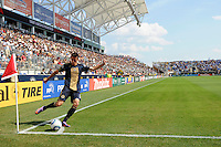 Sebastien Le Toux (9) of the Philadelphia Union takes a corner kick. The Philadelphia Union and the New England Revolution  played to a 1-1 tie during a Major League Soccer (MLS) match at PPL Park in Chester, PA, on July 31, 2010.