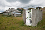 Two holer outhouse behing old one-room school and outhouse