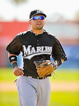 2 March 2011: Florida Marlins infielder Omar Infante returns to the dugout during a Spring Training game against the Washington Nationals at Space Coast Stadium in Viera, Florida. The Nationals defeated the Marlins 8-4 in Grapefruit League action. Mandatory Credit: Ed Wolfstein Photo